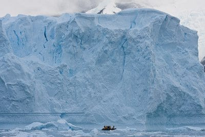 Zodiac in front of Iceberg (© Copyright - David Burren)