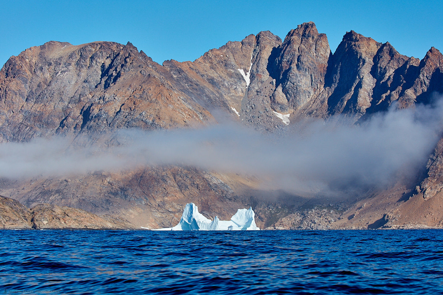 Iceberg with Mist and Mountains