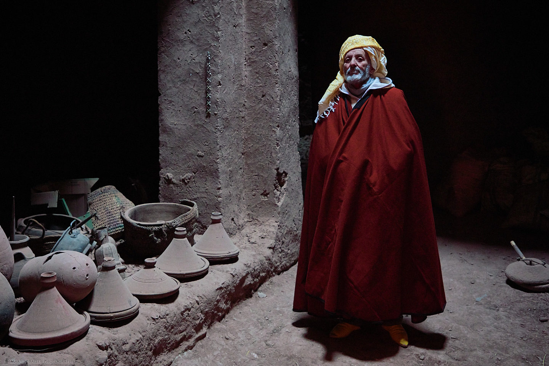 Moroccan Man in Adobe Building
