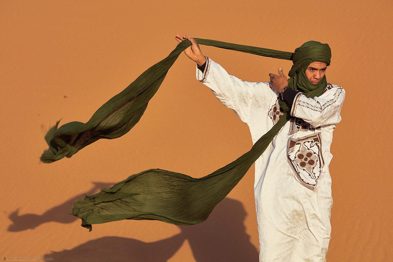 Young Moroccan Man Tying Turban