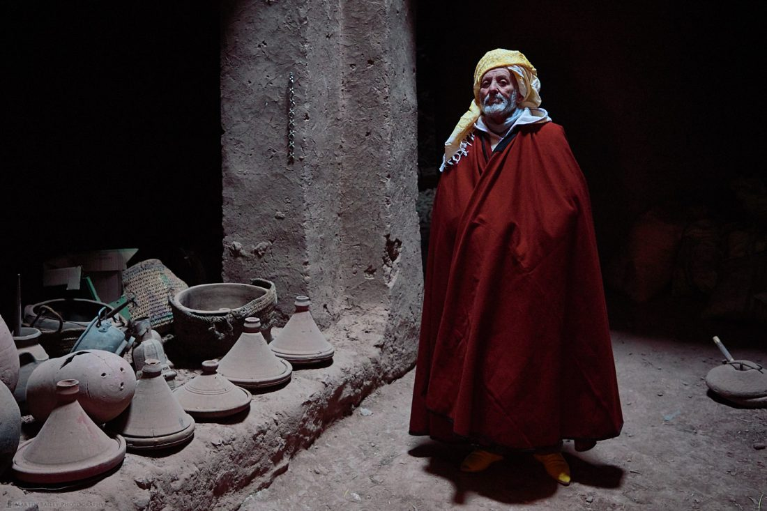 Moroccan Man in Adobe Building